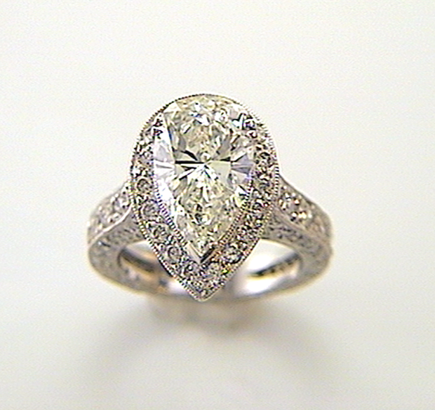 Pear Cut Diamond with Halo Engagement Ring