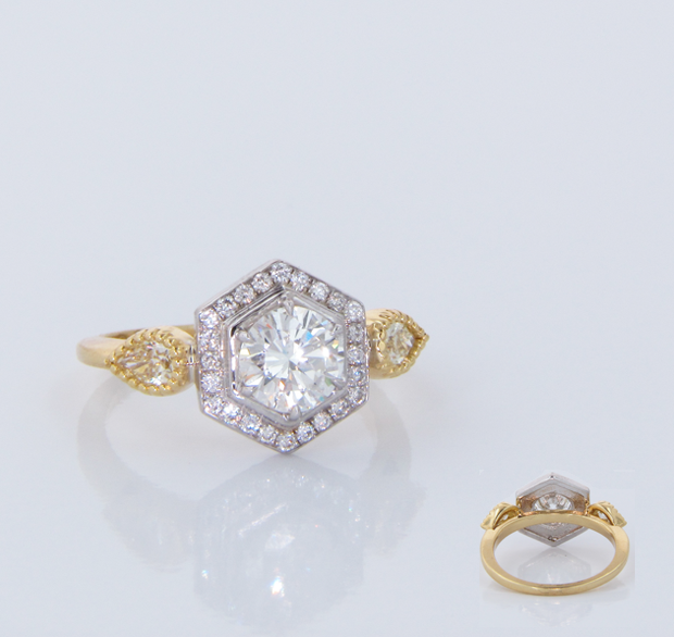 Brilliant White Round Cut Diamond Set in a Pavé Hexahedron Halo with Pear Sid